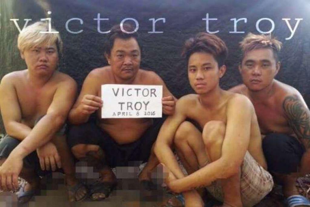 Gambar empat tebusan Malaysia  yang diculik oleh kumpulan Abu Sayyaf yang disiarkan di Facebook..