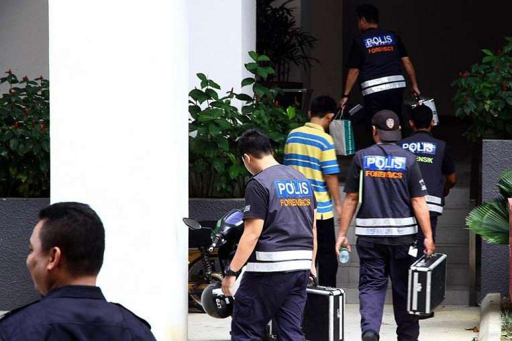 Polis di blok kondominium di Selangor di mana lima bom buatan sendiri ditemui pada Ahad (17 Apr) berikutan satu serbuan.
