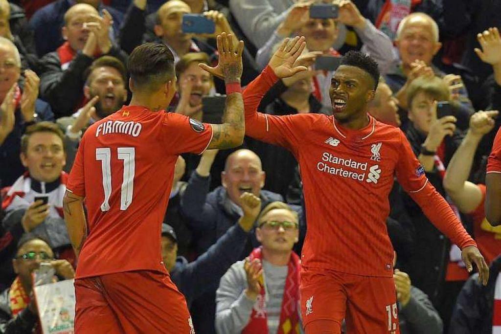 Sturridge (kanan) meraikan gol yang dijaringkannya bagi Liverpool.