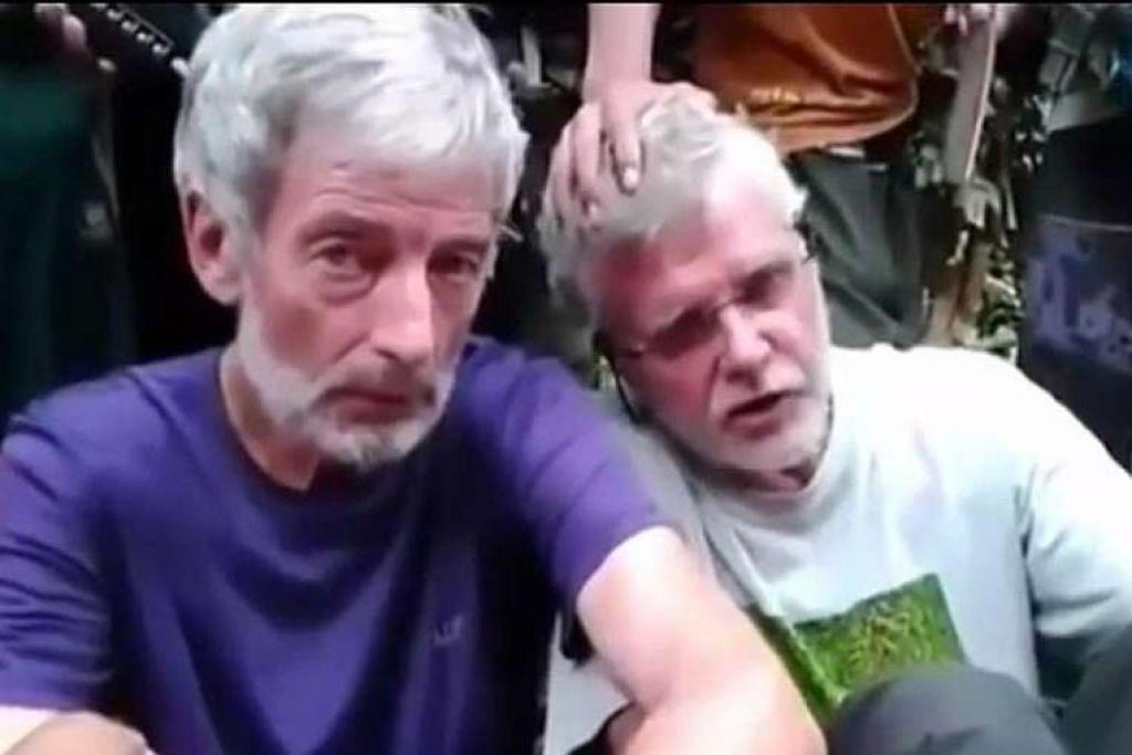 Encik Hall (kiri) dikatakan telah dipancung oleh Abu Sayyaf. Rakan senegaranya, Encik Ridsdel (kanan), dipancung pada April lalu.