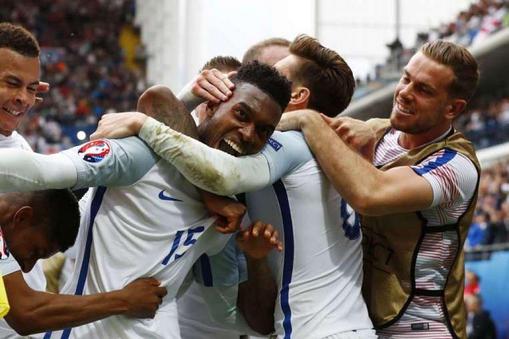 Daniel Sturridge meraikan jaringan golnya yang memberi England kemenangan 2-1 ke atas Wales.