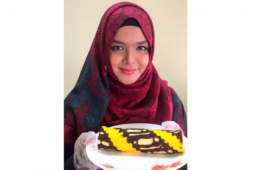 LUKISAN BAK INAI: Cik Siti Hanim menggabungkan kepakarannya dalam lukisan inai pada kek gulung batiknya. - Foto ihsan SITI HANIM OSMAN