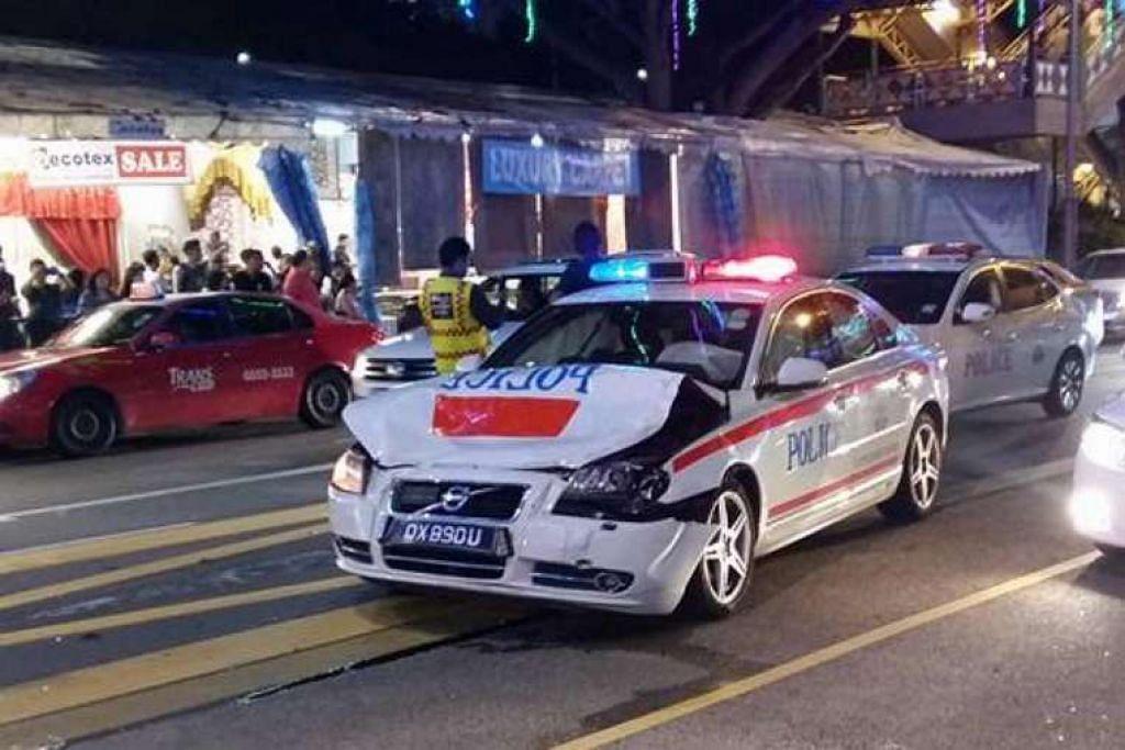 Bahagian depan dan hud kereta polis kemek teruk dan beg udara di tempat duduk pemandu diaktifkan dalam kejadian dekat bazar raya Geylang Serai.