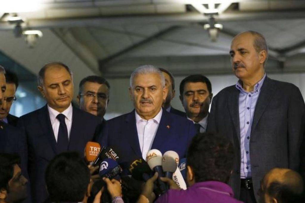 SERANGAN GANAS: Perdana Menteri Turkey, Encik Binali Yildirim, bercakap kepada pemberita di Lapangan Terbang Ataturk. - Foto REUTERS