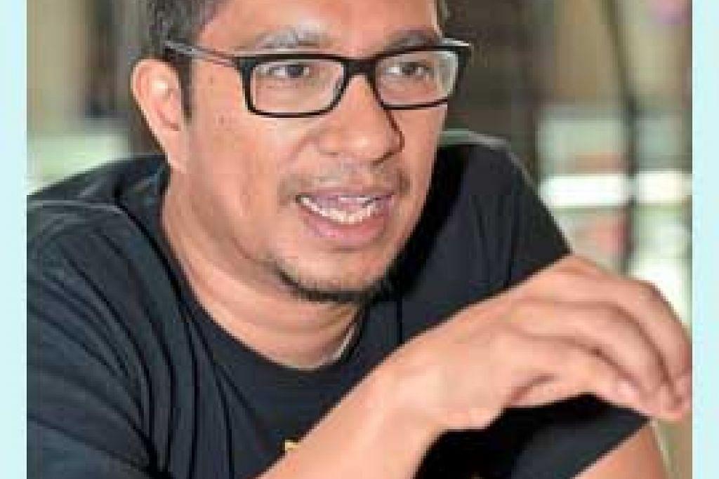 Pengendali bengkel Encik Amir Muhammad