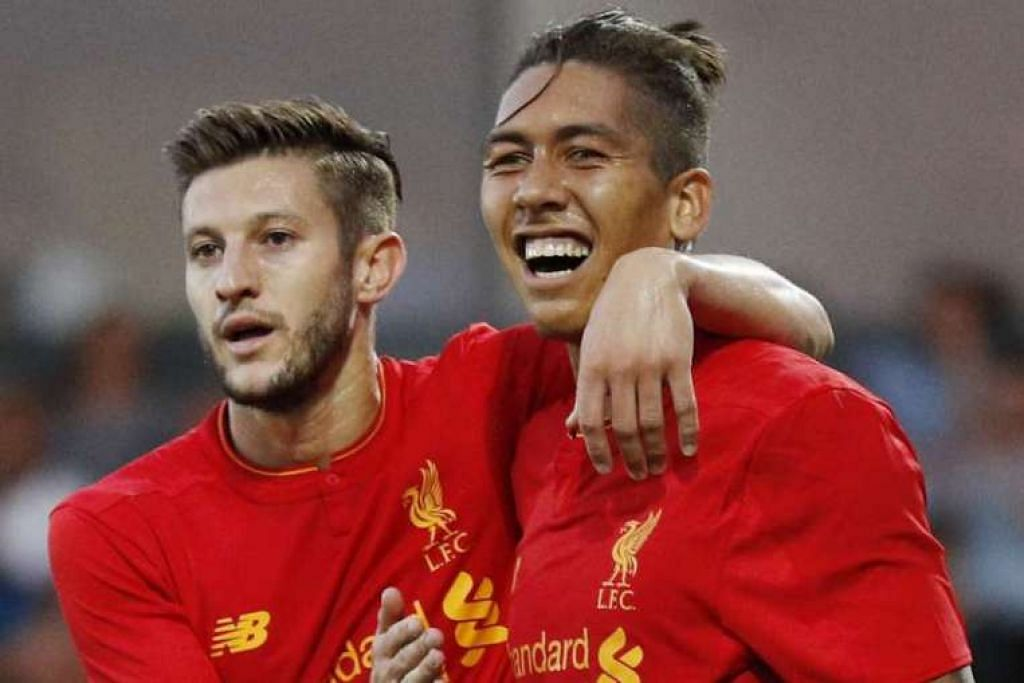 Roberto Firmino meraikan gol kedua Liverpool yang dijaringkannya bersama Adam Lallana.