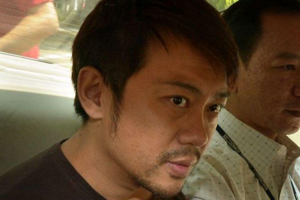 Yang Yin dalam kereta polis pada November 2014.