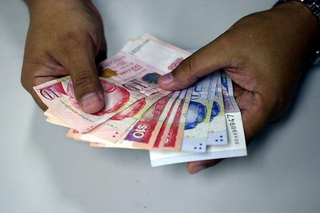 RAMALAN EKONOMI: Nilai dolar Singapura dijangka merosot ke paras pasca kemelesetan ekonomi jagat 2008 menurut pengamat yang ditukil Bloomberg. - Foto FAIL