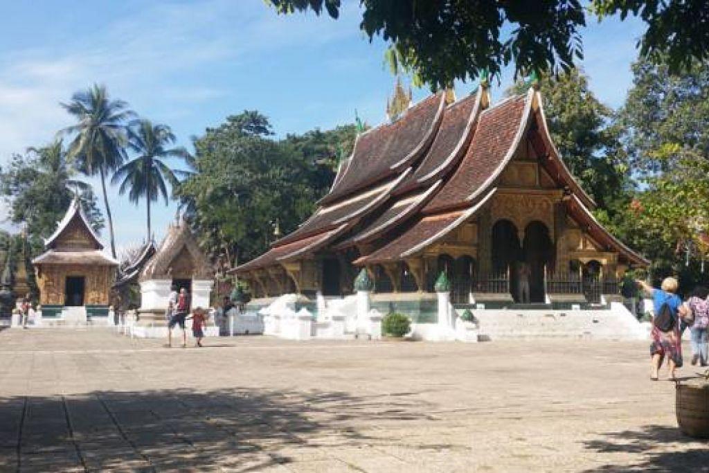 KUIL WAT XIENG THONG: Kuil di Luang Prabang ini dibina pada 1559 oleh Raja Setthathirath. Ia di bawah naungan keluarga diraja sehingga 1975, tempat raja-raja Laos dimahkotakan.