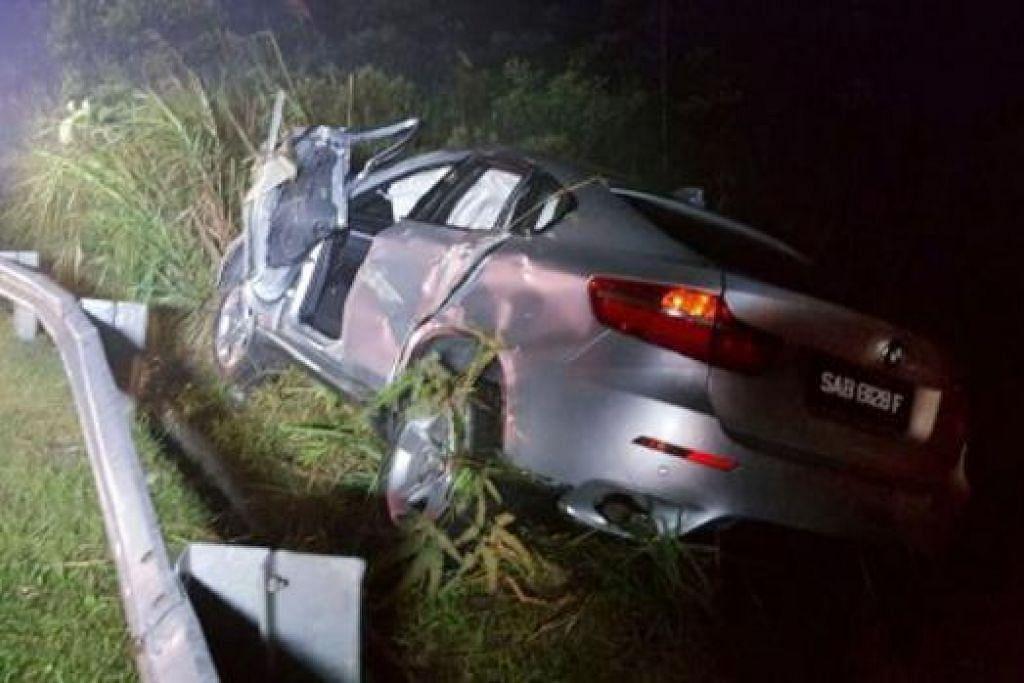 KERETA DITEMUI: Kereta jenis BMW X6 terbabas di Batu 18, Jalan Kimanis-Keningau, Sabah, malam kelmarin. - Foto BOMBA, TWITTER.COM