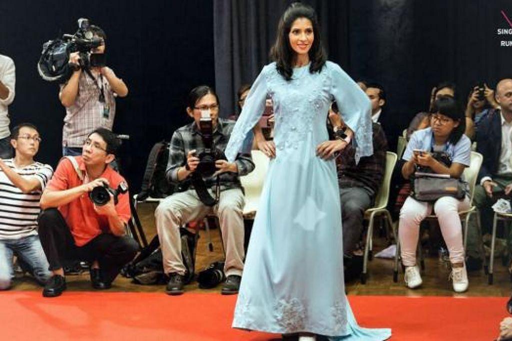 JAHITAN JADI PAPARAN: (Gambar atas) Gaun labuh dengan kemasan les dan manik jahitan Amnie Umaimah diperagakan seorang model di pertunjukan fesyen SG50 Singapore Fashion Runway pada tahun lalu. - Foto TAUFIK A. KADER, AMNIE UMAIMAH MOHD AMIN