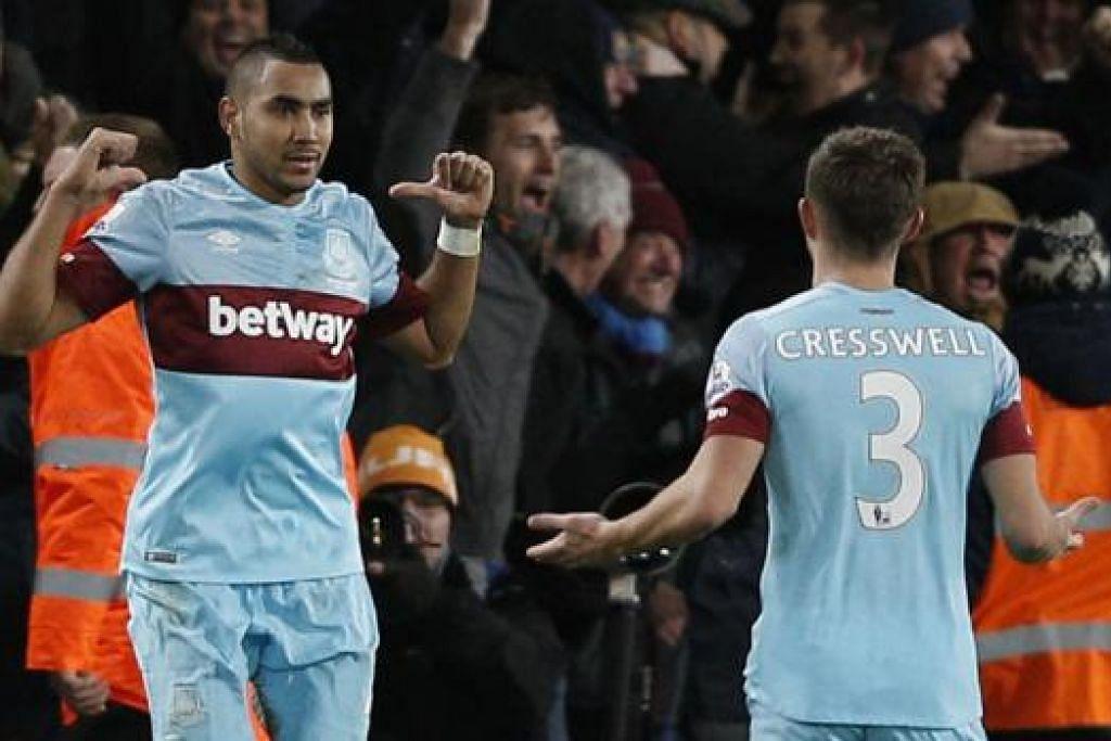 WIRA PASUKAN: Payet (kiri) meraikan golnya dalam perlawanan Liga Perdana England dengan Bournemouth semalam. - Foto AFP