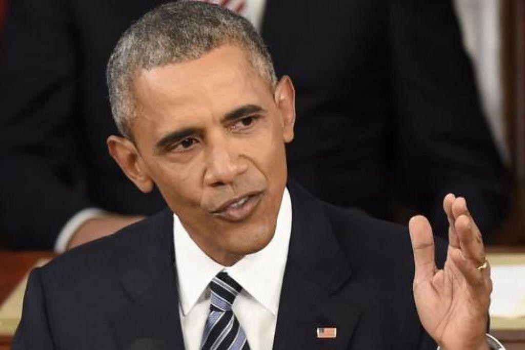 LAKAR HALA TUJU: Encik Barack Obama menyampaikan ucapan tahunan kepada Kongres buat kali terakhir semalam sebagai Presiden Amerika Syarikat. - Foto AFP