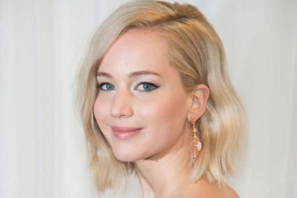PERNAH HIDUP SUSAH: Pertama kali ke New York semasa berusia 14 tahun, Jennifer Lawrence mengakui beliau pernah tinggal dalam apartmen yang kotor dan terdapat banyak tikus. Semua itu gara-gara kekurangan wang. - Foto AFP