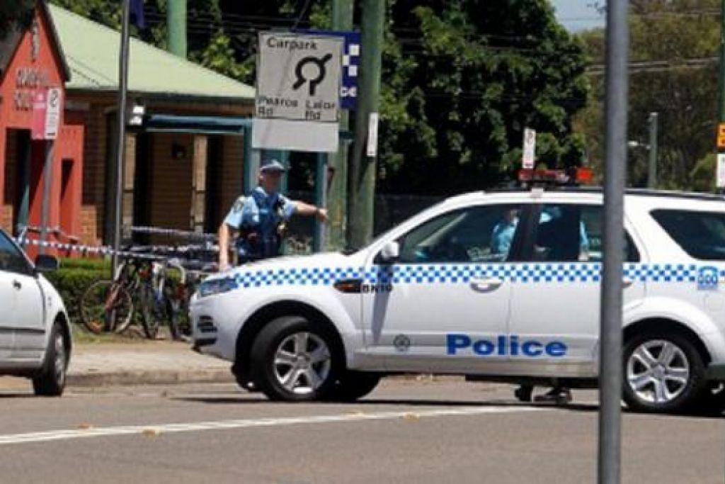 MOTIF BELUM DIKETAHUI: Polis Australia tidak menemui sebarang tanda berkaitan pengganasan dalam insiden terbaru di balai polis Quakers Hill di barat Sydney ini. - Foto SYDNEY MORNING HERALD