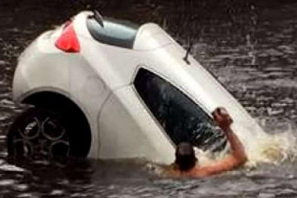 DISANJUNG: Gambar ini, yang diambil daripada rakaman video, menunjukkan seorang lelaki cuba memecahkan tingkap kereta untuk menyelamatkan anak kecil yang terperangkap di dalamnya. - Foto YOUTUBE