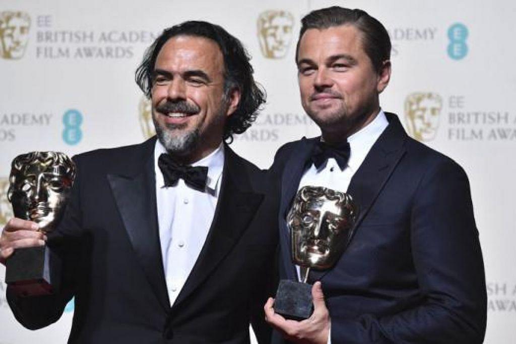 ANUGERAH BERGANDA: Pelakon filem The Revenant, Leonardo Dicaprio (kanan), yang menerima anugerah bagi pelakon lelaki terbaik bersama pengarah filem tersebut, Alejandro Gonzalez Inarritu, sebagai pemenang anugerah bagi pengarah terbaik di BAFTA 2016, pada Ahad lalu. - Foto AFP