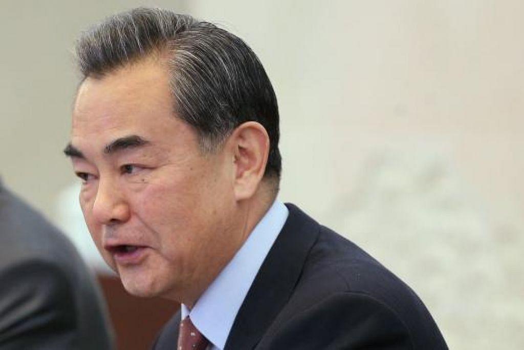 Menteri Luar China, Encik Wang Yi, berharap media Barat memberi lebih perhatian pada rumah api yang sedang dibina China di rantau ini. Gambar REUTERS