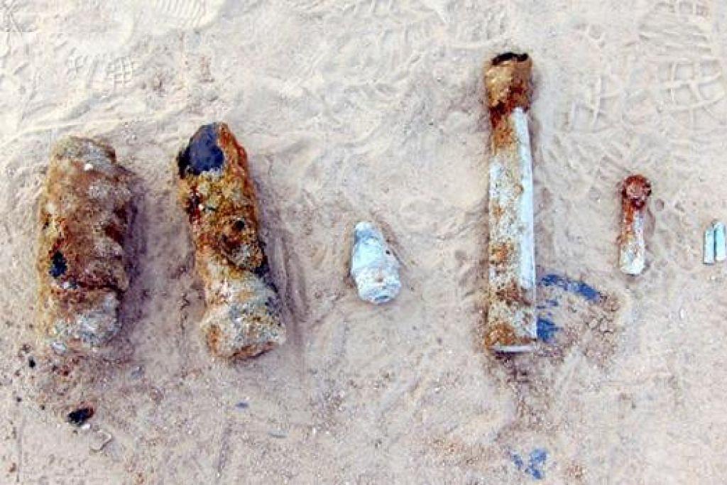 PELURU DAN KARTRIJ PERANG: (Dari kiri) Dua butir peluru meriam, sebuah fius peledakan, sebutir peluru antipesawat, sebuah katrij kosong berukuran 0.5 inci serta dua katrij kosong 0.303 inci ditemui di tapak binaan di Changi. - Foto THE SINGAPORE ARMY FACEBOOK