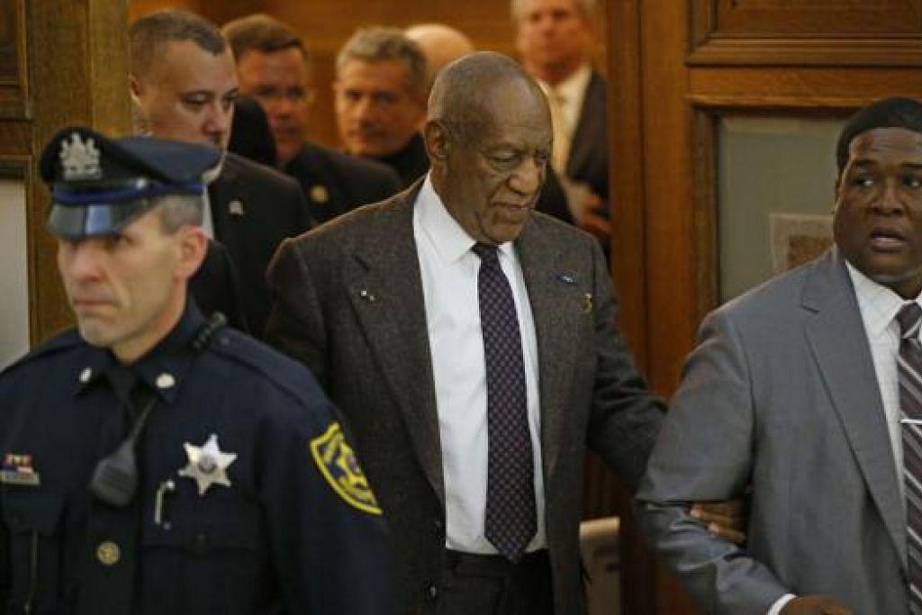 AMBIL TINDAKAN: Cosby (tengah) mendakwa Cik Constand melanggar perjanjian yang dicapai dalam penyelesaian saman sivil terdahulu berkaitan serangan seksual pelawak itu ke atasnya. - Foto REUTERS