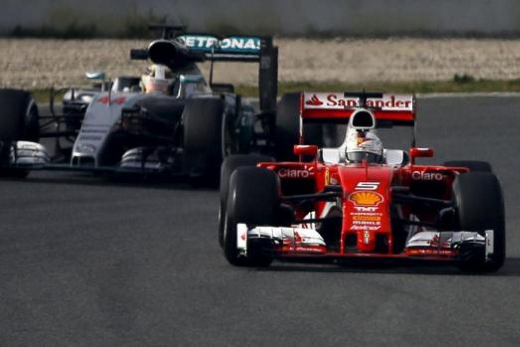 SALING UJI: Bintang Ferrari, Sebastian Vettel, berada di hadapan juara dunia Formula Satu, Lewis Hamilton, di sesi ujian yang bermula di Barcelona, Sepanyol, kelmarin. - Foto REUTERS