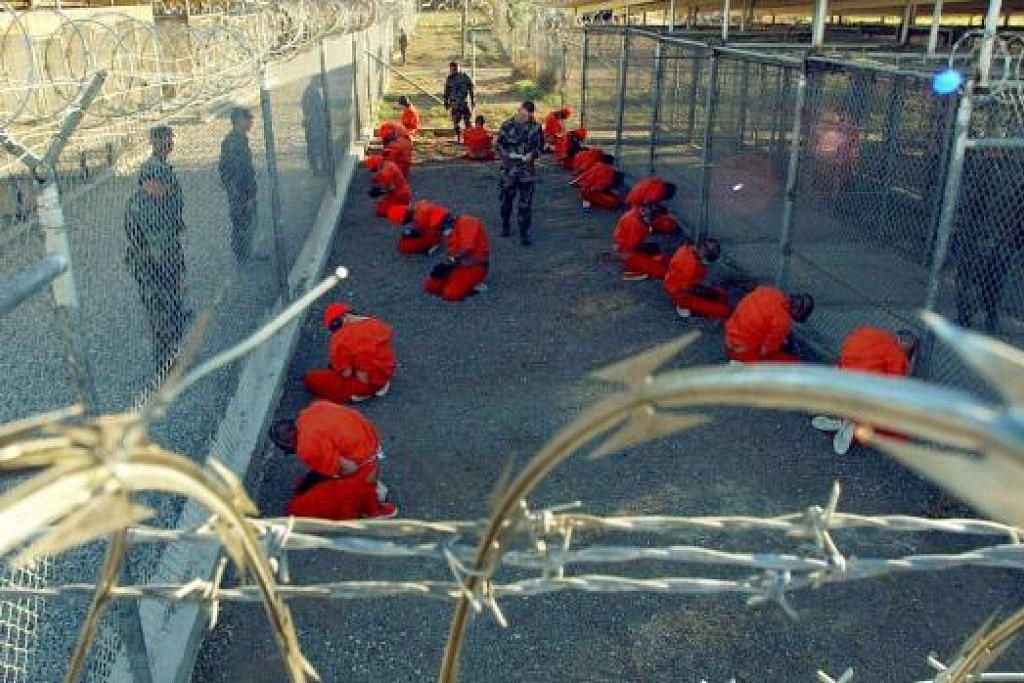 Penjara Guantanamo pernah menempatkan kira-kira 700 suspek serangan 9/11 dan menjadi sinonim di seluruh dunia dengan penyeksaan, penahanan dan jumpsut berwarna oren. Gambara fail REUTERS