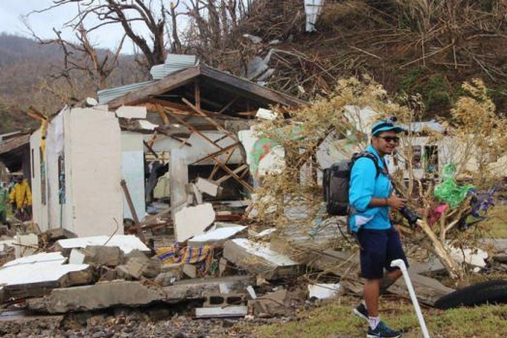 KESAN TAUFAN: Sebuah rumah yang ranap di Pulau Koro adalah antara kemusnahan akibat taufan Winston. Bantuan mula tiba dan kerja-kerja pemulihan dimulakan. - Foto AFP
