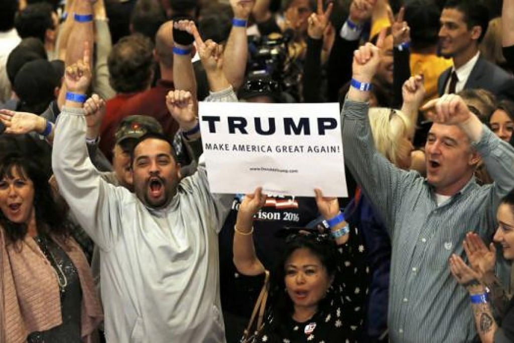 MENANG: Para penyokong Encik Donald Trump bersorak gembira selepas kemenangannya di Nevada diumumkan. - Foto REUTERS