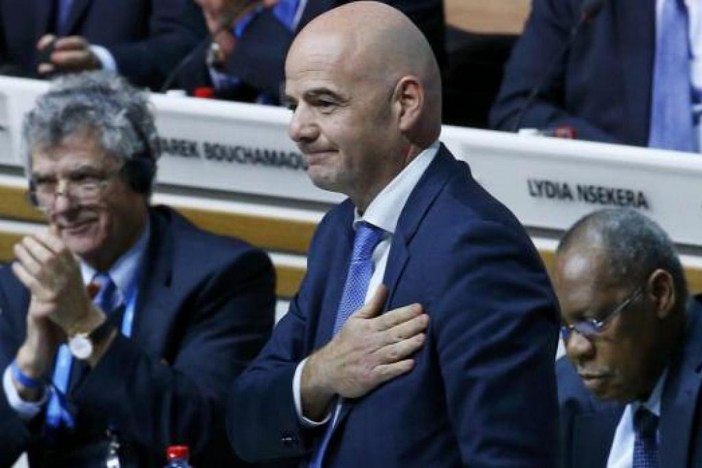TANGGUNGJAWAB BESAR: Presiden baru Fifa, Gianni Infantino (kanan), jelas terharu dengan sokongan daripada anggota badan bola sepak dunia itu. - Foto REUTERS