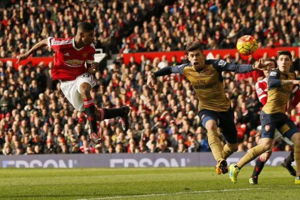 Marcus Rashford menjaringkan gol kedua Manchester United, yang mengalahkan Arsenal 3-2 dalam perlawanan Liga Perdana Inggeris (EPL) di Old Trafford pada Ahad (28 Feb). Gambar REUTERS