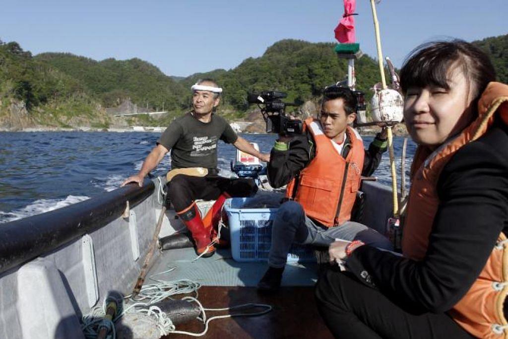 Kecekalan mangsa tsunami Jepun suntik semangat positif PAMERAN FOTO JELAJAH