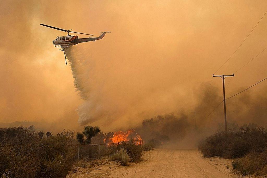 AS hadapi banjir, kebakaran hutan