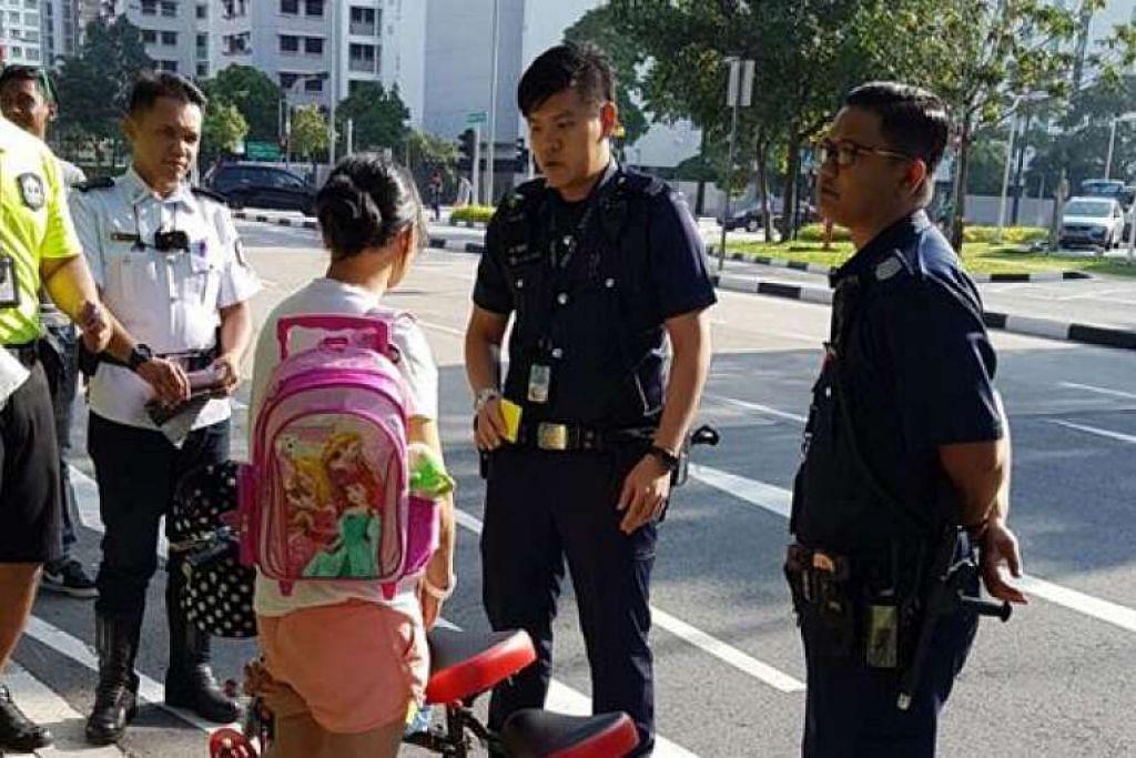 E-skuter wanita ini dirampas LTA kerana beliau memandunya bersama anaknya di jalan raya.