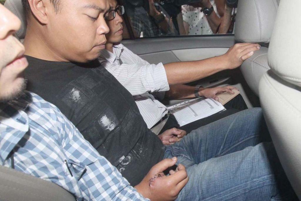 Iskandar dibawa polis pada Julai 2013.