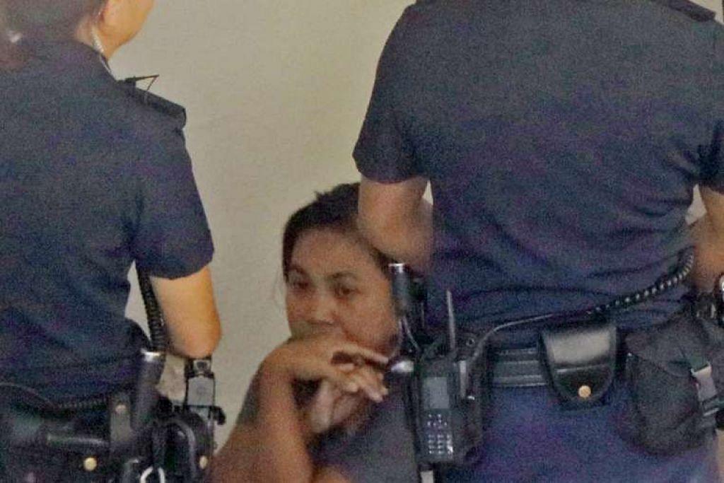 Minah, yang kelihatan bersama pegawai polis pada Isnin (13 Feb), dikenakan tuduhan bunuh pada Rabu.