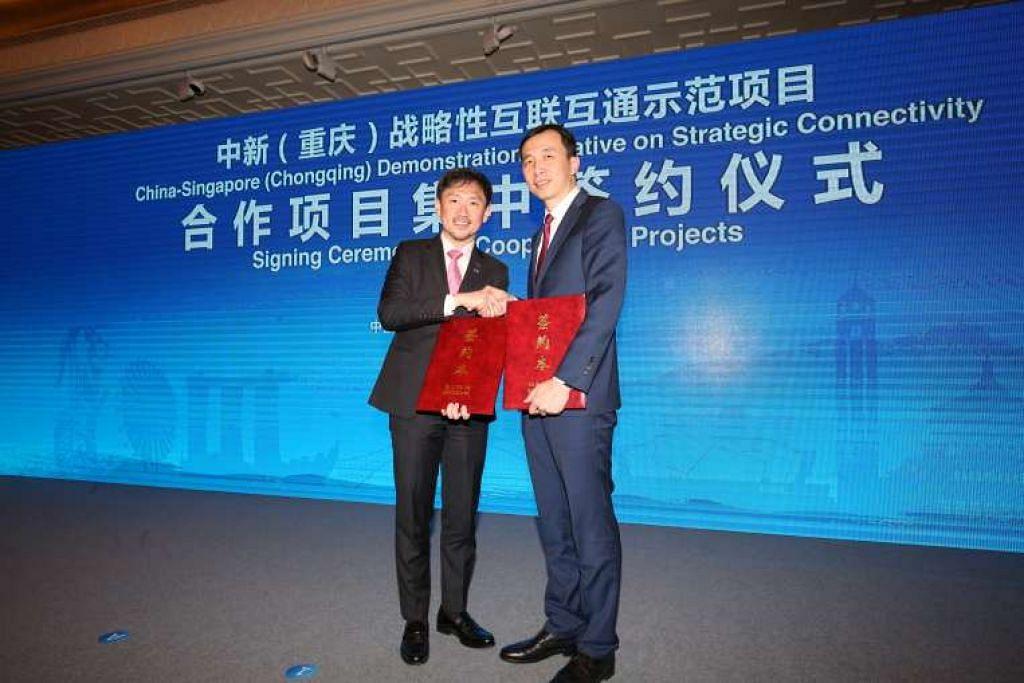 Perjanjian usaha sama itu ditandatangani oleh Timbalan Ketua Eksekutif SPH, Encik Anthony Tan (kiri), dan Presiden ZBJ Network, Inc., Encik Wang Nan, di Beijing.