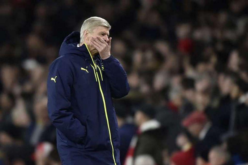 Pengurus Arsenal Arsene Wenger kelihatan hampa selepas pasukannya tumpas 5-1 di tangan Bayern Munich dan tersingkir daripada Liga Juara-juara.