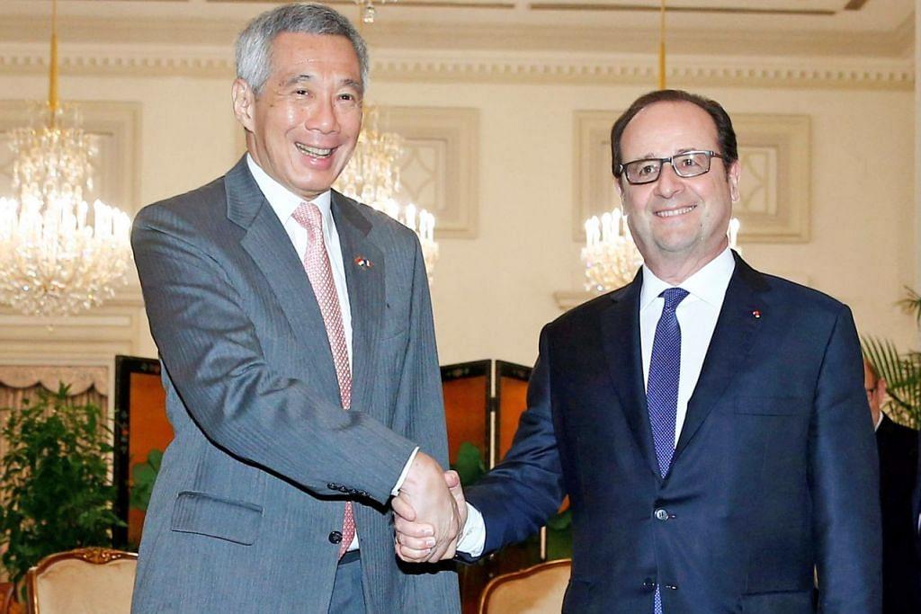 KOMITMEN PADA INOVASI: Encik Lee dan Encik Hollande, yang bertemu di Istana semalam, turut mengeluarkan pengisytiharan bersama mengenai inovasi di kedua-dua negara. - Foto REUTERS