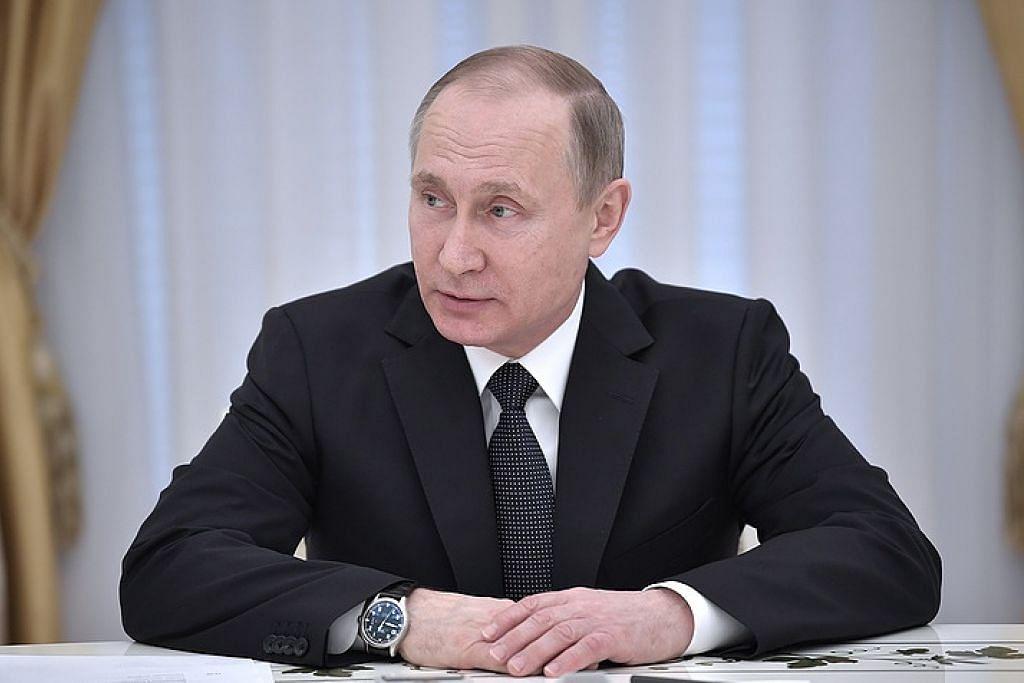 PERTAHAN SYRIA: Presiden Vladimir Putin berkata serangan udara Amerika ke atas pangkalan udara Syria telah melanggar undang-undang antarabangsa. - Foto ITAR-TASS