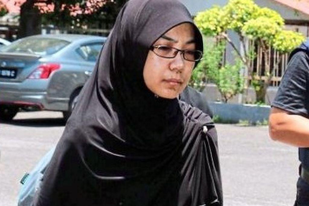 PENGARUH ISIS: Bekas penuntut sarjana Universiti Malaya, Siti Noor Aishah Atam, yang didakwa memiliki buku berkaitan kumpulan pengganas, dikatakan mahu membunuh diri jika hasratnya untuk berjihad di Syria dihalang. - Foto THE STAR