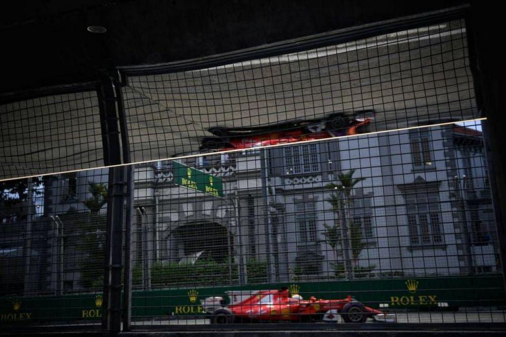 GRAND PRIX SINGAPURA: Pemandu Ferrari, Sebastian Vettel, semasa beraksi di sesi kelayakan di Litar Marina Bay tadi menjelang perlumbaan Grand Prix Singapura Singapore Airlines malam esok.