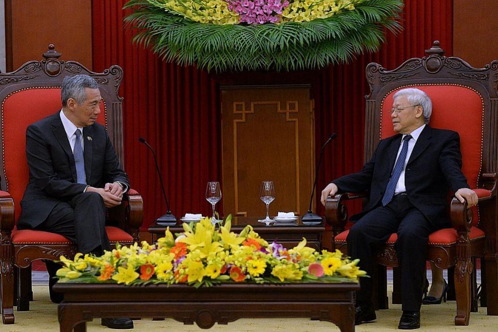 LAWATAN PM LEE KE VIETNAM PM Lee: S'pura akan terus sertai TPP