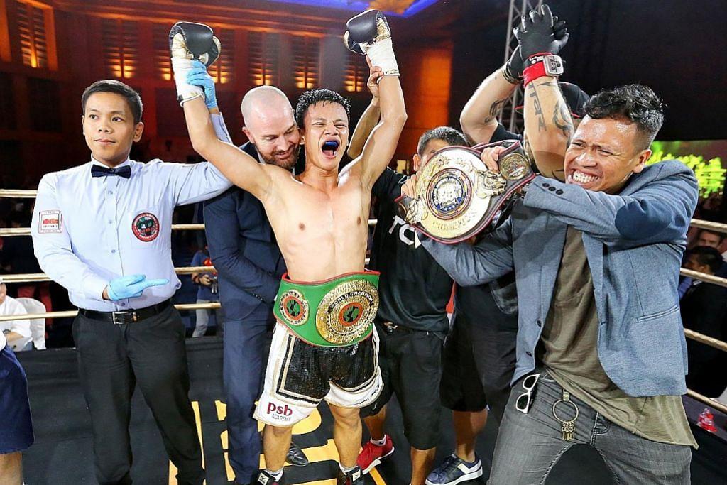 TINJU Ridhwan juara dunia sulung S'pura