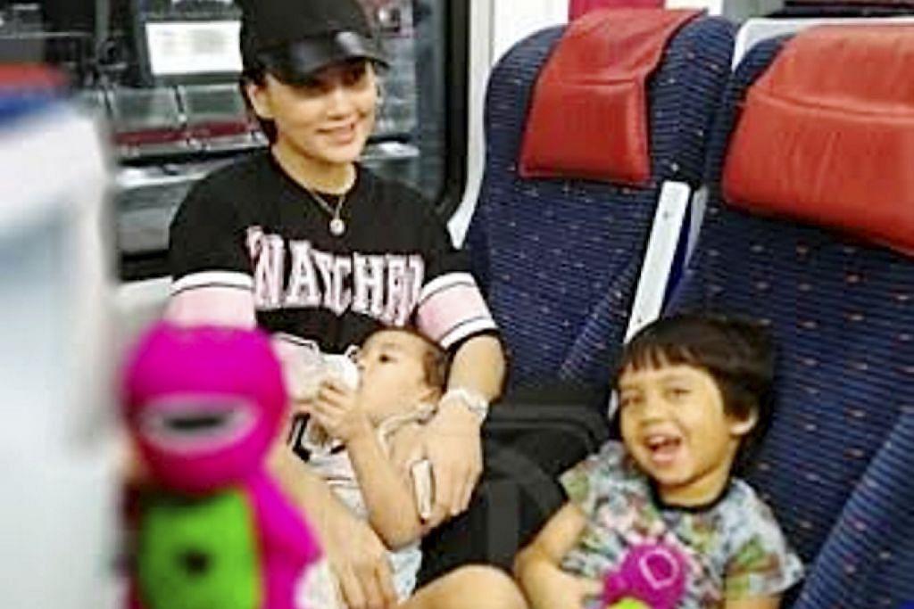 Fasha balik kampung naik kereta api
