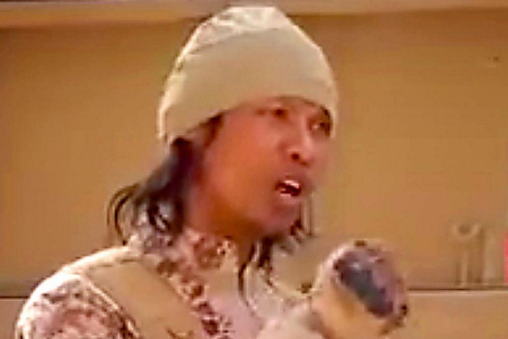 MUNCUL DALAM VIDEO: Rakyat Singapura yang menyertai ISIS, Megat Shahdan Abdul Samad, dalam satu video propaganda. - Foto fail daripada FACEBOOK