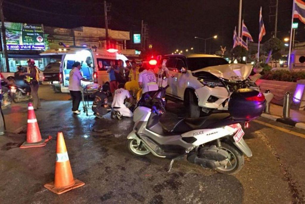KEMALANGAN DI PHUKET: Kereta Toyota Fortuner berwarna putih yang dipandu warga Singapura, Encik Ang Koh Lin, di Phuket terbabas dekat Monumen Dua Wirawati di pulau peranginan itu.