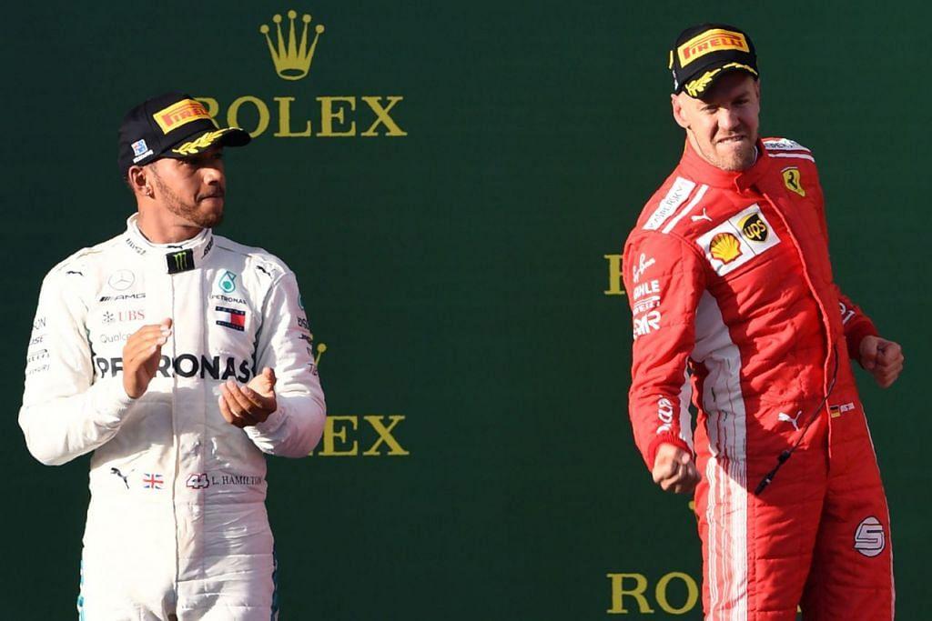 MULA DENGAN BERGAYA: Sebastian Vettel (kanan) meraikan kemenangan selepas mengatasi juara dunia Lewis Hamilton (kiri) dalam perlumbaan sengit aksi pembukaan Formula Satu (F1) untuk menjuarai Grand Prix (GP) Australia. - Foto AFP