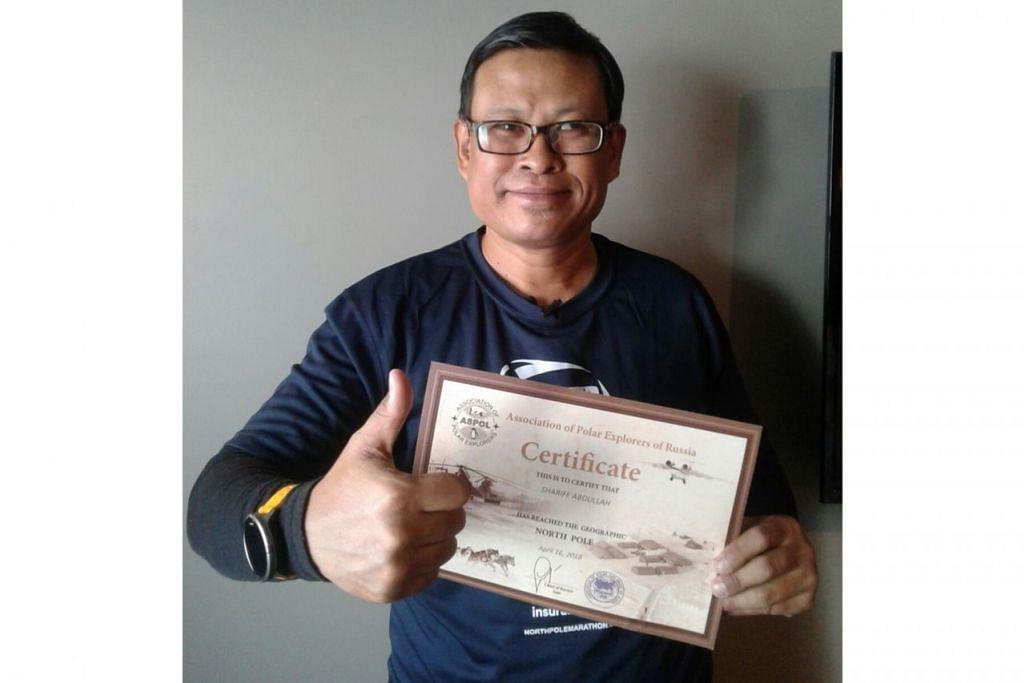 PENGALAMAN LUAR BIASA: Shariff menunjukkan sijil yang menunjukkan kejayaan beliau menjejakkan kaki di Kutub Utara - sesuatu yang boleh diimpikan oleh kebanyakan atlit lain. - Foto ihsan MD SHARIFF ABDULLAH
