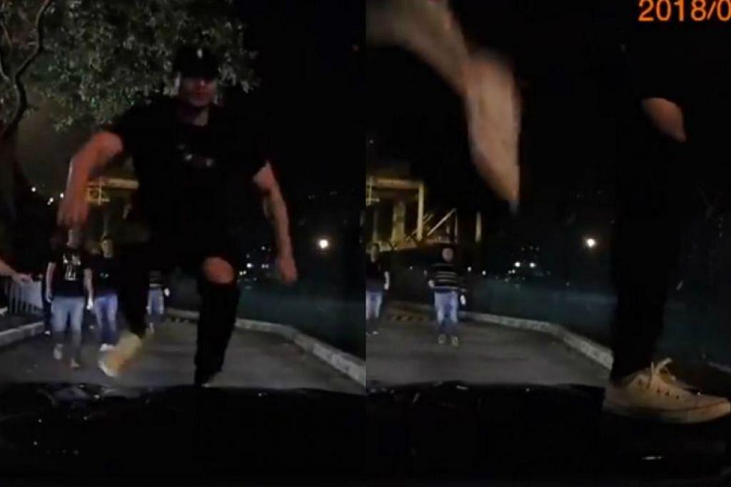DITANGKAP POLIS: Lelaki yang dirakam melompat ke atas bonet sebuah kereta sebelum menghentakkan kakinya pada cermin depan kereta tersebut telah ditangkap polis.