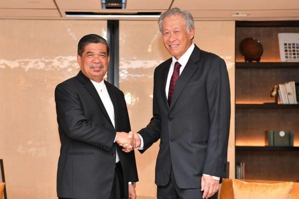 PERERAT HUBUNGAN: Encik Mohamad (kiri) bertemu dengan Dr Ng buat pertama kali pada 3 Jun,  sejak Encik Mohamad dilantik menjadi Menteri Pertahanan Malaysia.